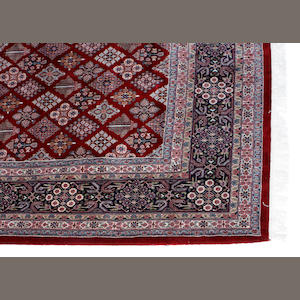 An Indian carpet size approximately 11ft. 10in. x 18ft.