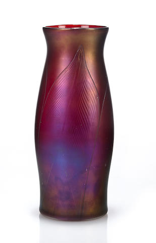 An early Loetz feather-decorated iridescent blue glass vase 1898-1899