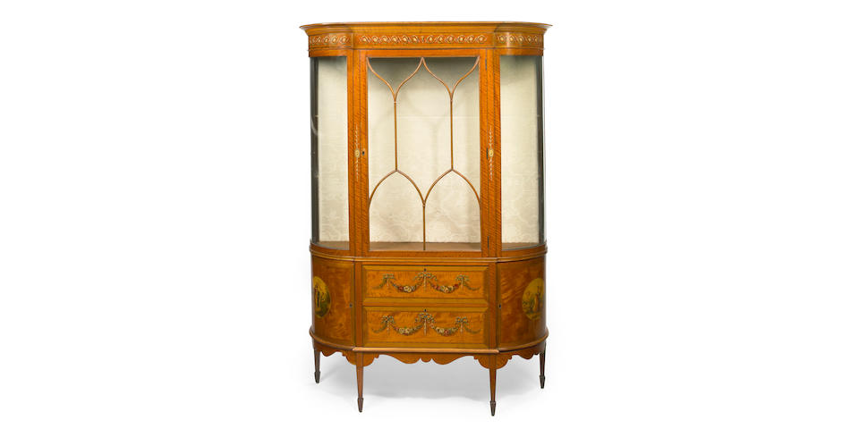 A Sheraton Revival paint decorated satinwood display cabinet