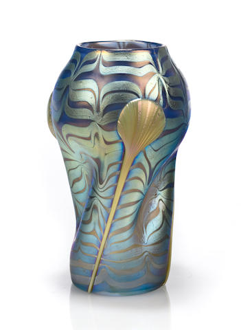 A Loetz  decorated and applied iridescent glass vase circa 1900