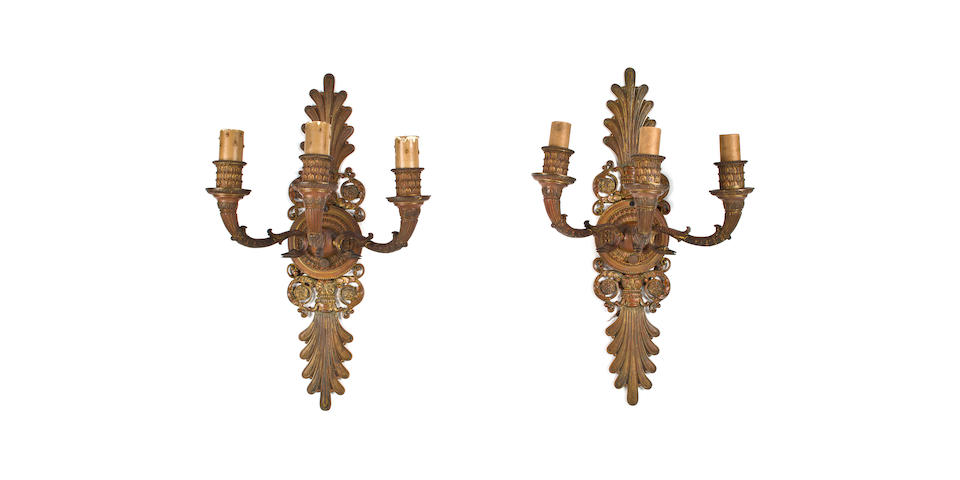 A pair of Caldwell gilt bronze two-light wall lights