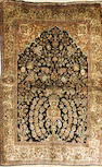 A silk Qum rug size approximately 3ft. 7in. x 5ft. 3in.