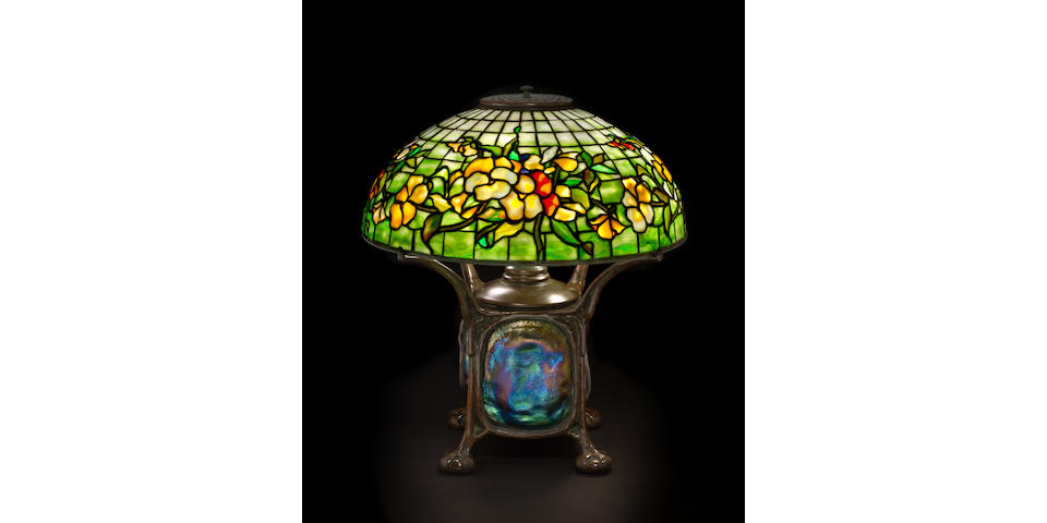 A Tiffany Studios leaded glass Pansy shade on a modern bronze and turtleback tile base the shade, circa 1910