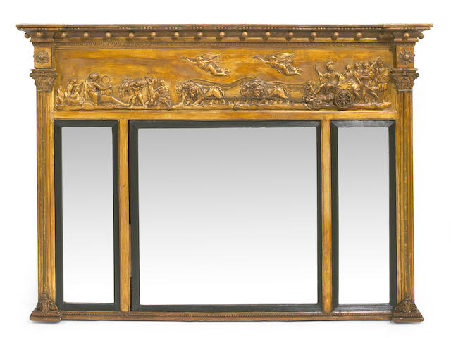 A Regency style parcel ebonized giltwood and gesso mirror