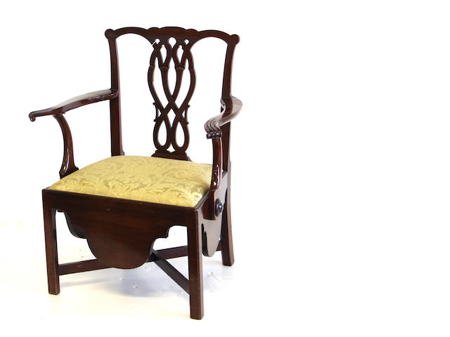 An unusual George III mahogany commode chair with retractable arms fourth quarter 18th century