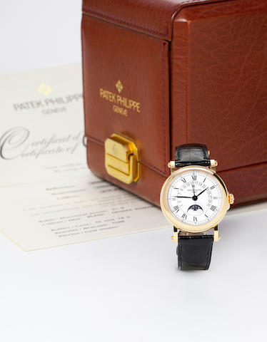 Patek Philippe. A fine 18K rose gold automatic center seconds watch with retrograde perpetual calendar and moon phasesRef.5059R, Movement no.1957342, Case no.4047980,
