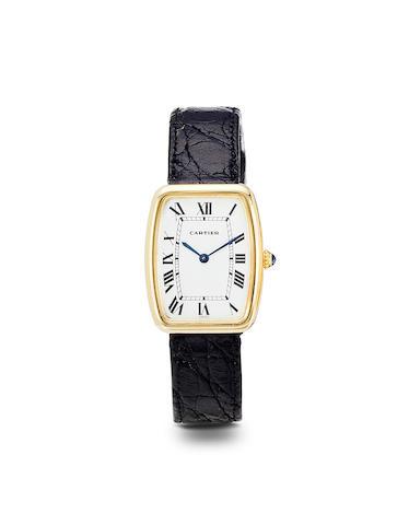 Cartier. An 18K gold shaped tonneau wristwatchSquare Incurvée, 1970's