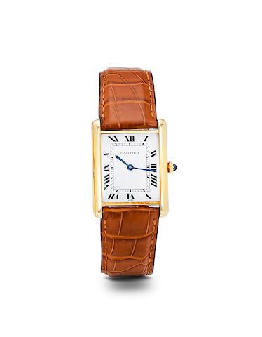Cartier. An 18K gold automatic Tank wristwatchNo. 170110023, 1980's