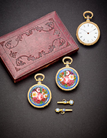 Boyer à Genève. A fine and very rare mirror image pair of floral enameled 18K gold watches in original box with enameled keysNos. 9899 and 9900, circa 1850