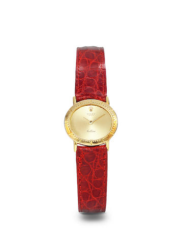 Rolex. An 18K gold lady's wristwatch and an 18K gold deployant claspCellini, Ref: 4081, the clasp signed Cartier, K 00769, 1990's