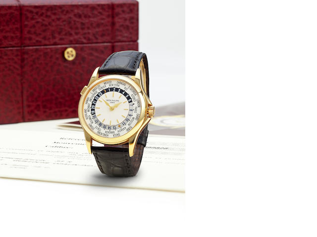 Patek Philippe. A fine 18K gold automatic world time wristwatchRef: 5110J-001, Case no. 4099828, Movement no. 3206243, sold 2001