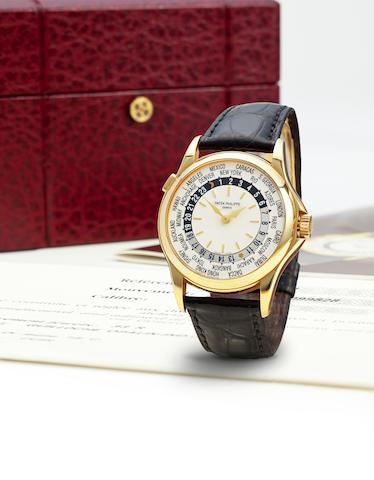 Patek Philippe. A fine 18K gold automatic world time wristwatchRef: 5110J-001, Case no. 4099828, Movement no. 3206243, sold 2001