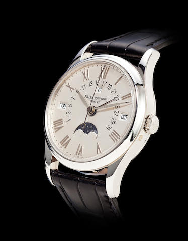 Patek Philippe. A fine and very rare roman numeral dial platinum automatic center seconds wrist watch with retrograde perpetual calendar and moon phasesRef: 5050P, Case No. 2989769, Movement No. 1957953