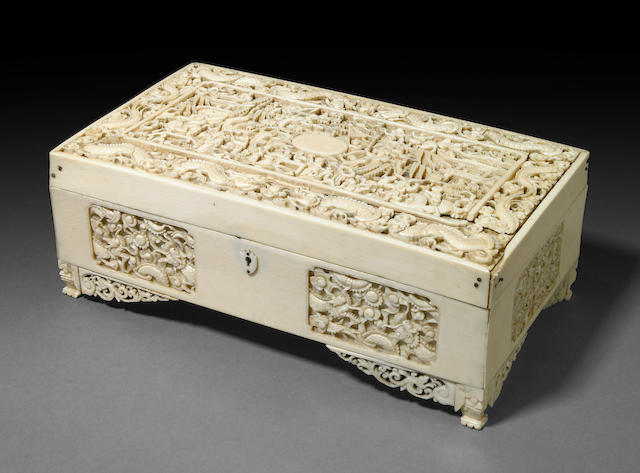 A Chinese carved ivory export lidded box (crack to the top)