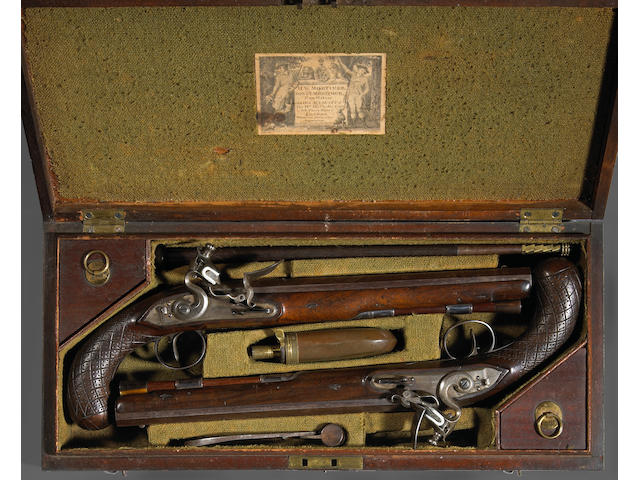 A cased pair of English flintlock dueling pistols by H.W. Mortimer