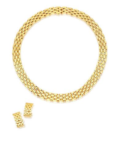 An eighteen karat gold necklace and pair of earrings, Cartier,