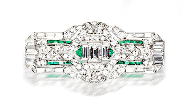 An art deco diamond and emerald brooch,