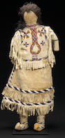 An Apache beaded doll