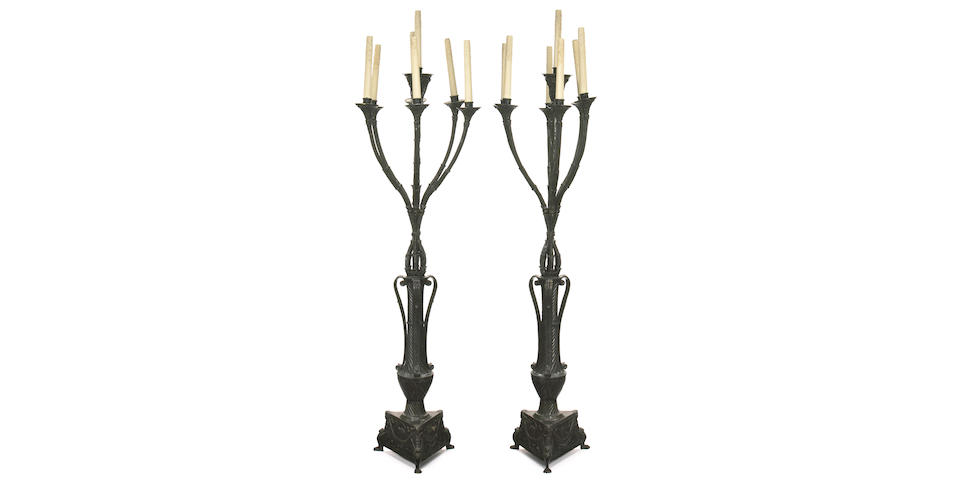 A pair of American patinated bronze seven light torchères attributed to Bernard Maybeck 1902-03