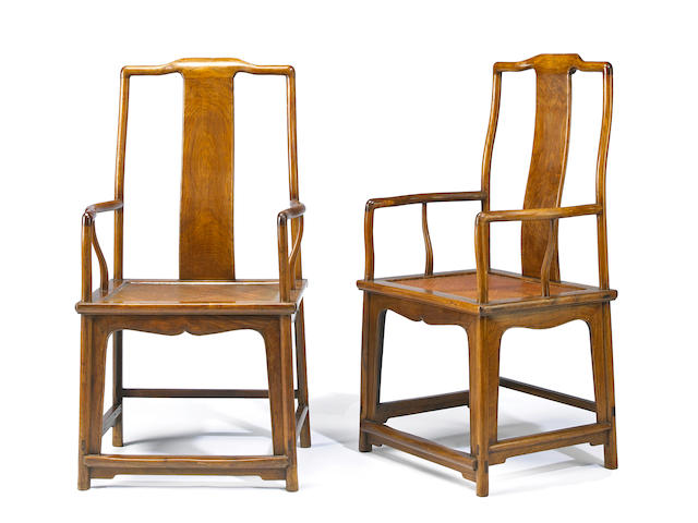 A pair of huanghuali arm chairs Late 20th century