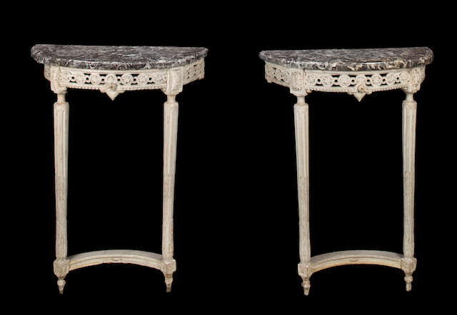 A pair of Louis XVI carved and painted consoles with variegated grey marble tops stamped DUMAGNY fourth quarter 18th century