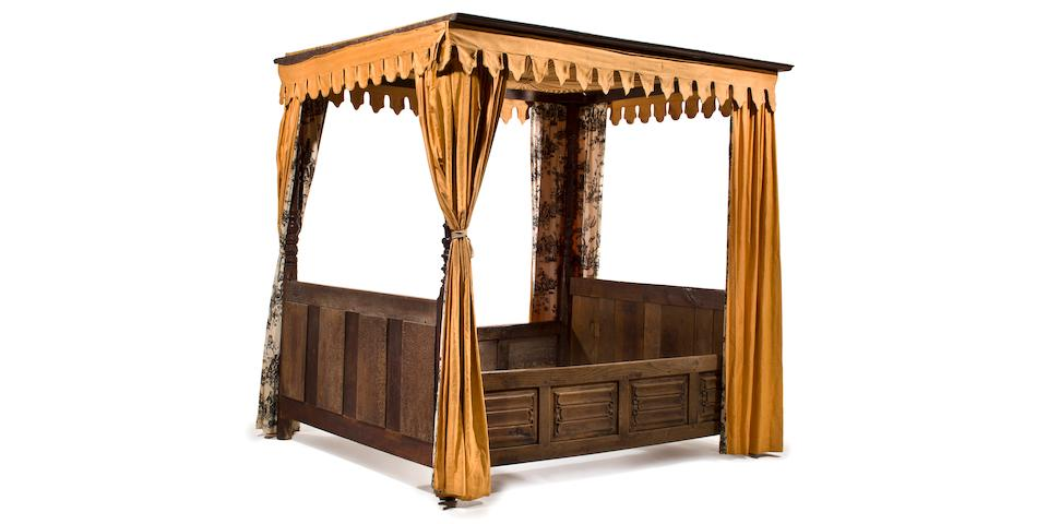 An Elizabethan style oak four poster canopy bed late 19th/early 20th century