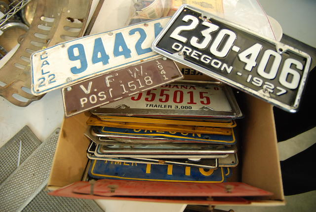 A box of vintage licence plates