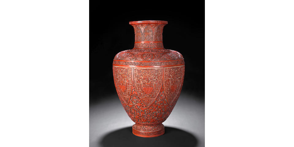 A fine red, black and yellow carved lacquer baluster vase 18th Century