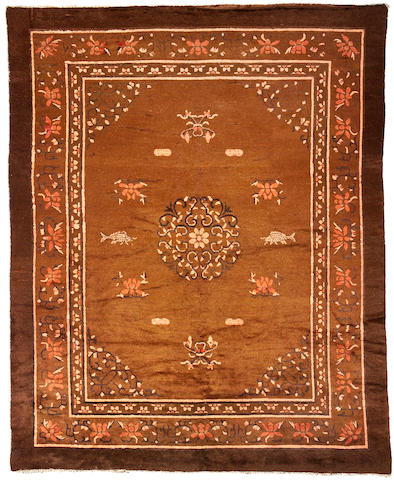 A russet ground wool pile carpet Late 19th Century