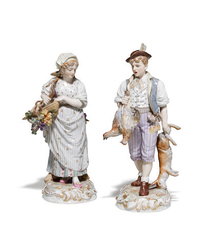 A pair of Hochst porcelain figures of peasants celebrating the harvest and the hunt late 19th/early 20th century