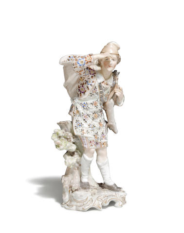 A German porcelain figure of a game gatherer late 19th/early 20th century