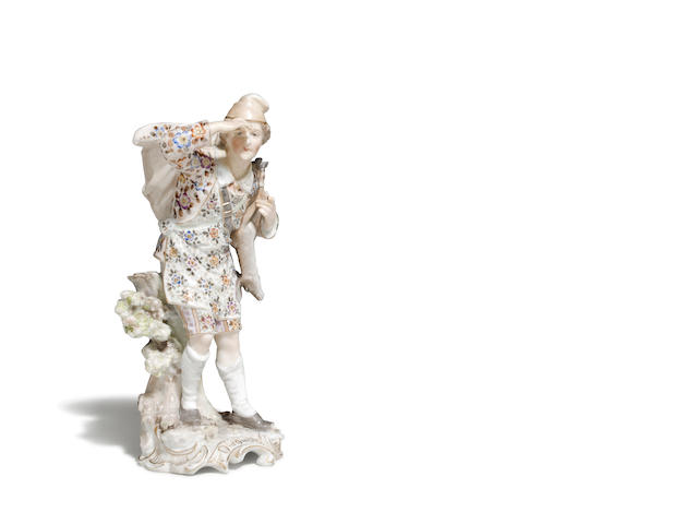 A Continental porcelain figure of a game gatherer