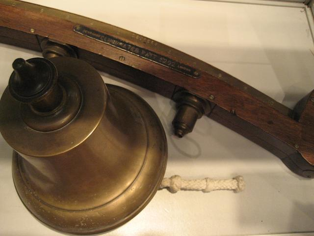 A mahogany clinometer and a bronze ship's bell 2