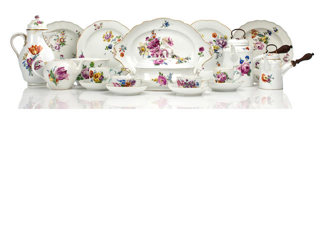Meissen coffee pot, teapot, two graduated chocolate pots, waist bowl, six serving bowls, five dinner plates, two coffee cups, four teacups and five saucers, covered dish and small tray with up-turned handles