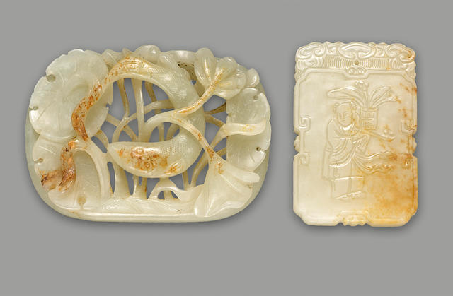 Group of two jade carvings, one celadon and russet tinged fish and waterplants group, one pendant