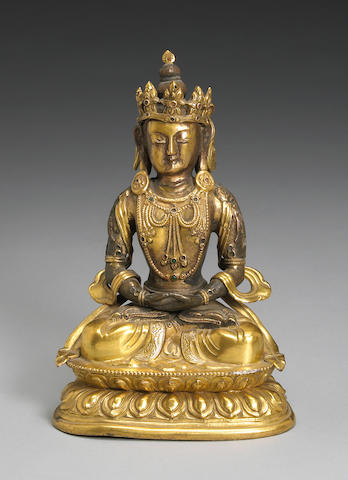 A Sino-Tibetan bronze figure of seated Buddhist deity, 19th Century