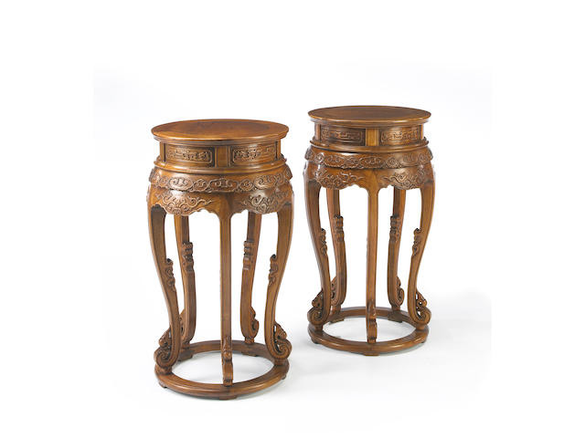 A pair of huanghuali and mixed wood circular tables