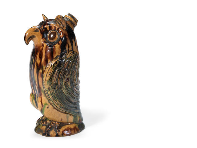 An important and rare Moravian glazed pottery owl bottle Salem or Bethabara, North Carolina first quarter 19th century