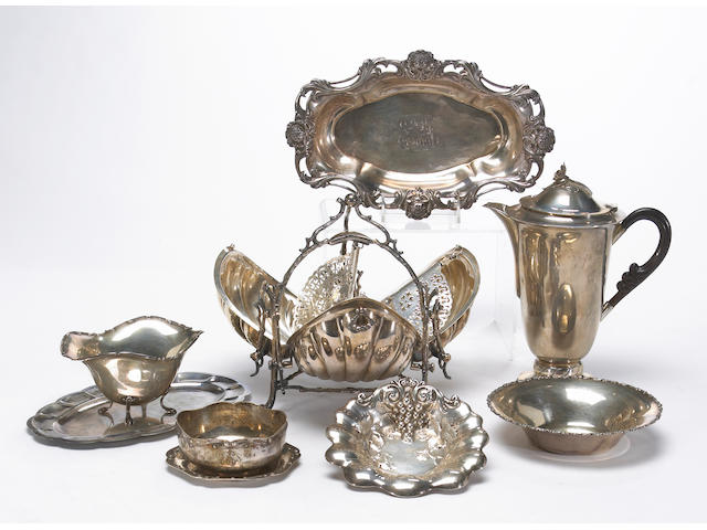 A group of sterling table articles with a plated biscuit box