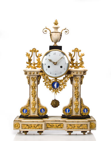 A Louis XVI marble and gilt bronze mantel clock wtih Sevres plaques