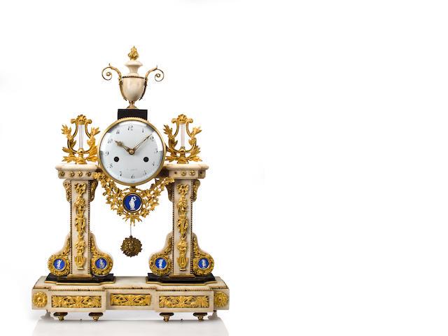 A Louis XVI marble and gilt bronze mantel clock wtih Sevres plaques