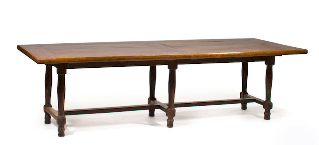 A French provincial oak refectory table with associated top<br>the base 18th century, the top first half 19th century