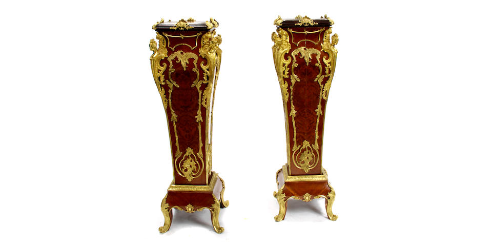 A pair of Louis XV style gilt bronze mounted marble top stands
