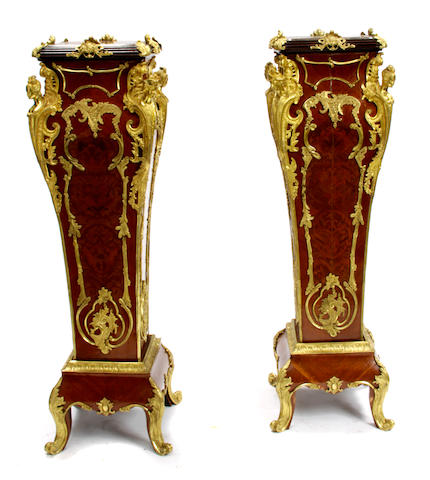 A pair of Louis XV style gilt bronze mounted pedestals