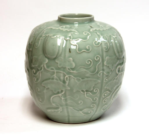 A celadon glazed porcelain melon-form jar 20th Century