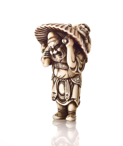 An ivory netsuke of Shoki and an oni Early 19th century