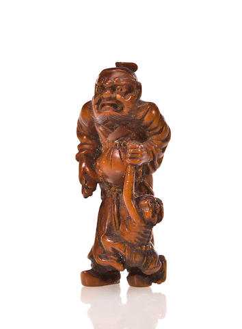 Wood netsuke of Shoki holding an oni, by Masakazu