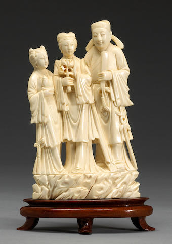 A carved ivory figural group 20th century