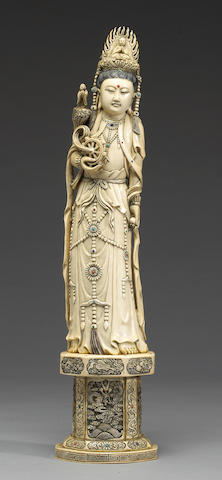 A pieced and tinted ivory Chinese figure of Guanyin, 20th century