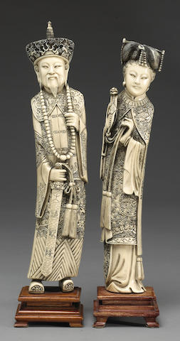 A pair of carved ivory figures of an emperor and empress 20th Century